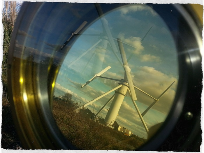 A look at a wind turbine through a magnifying glass